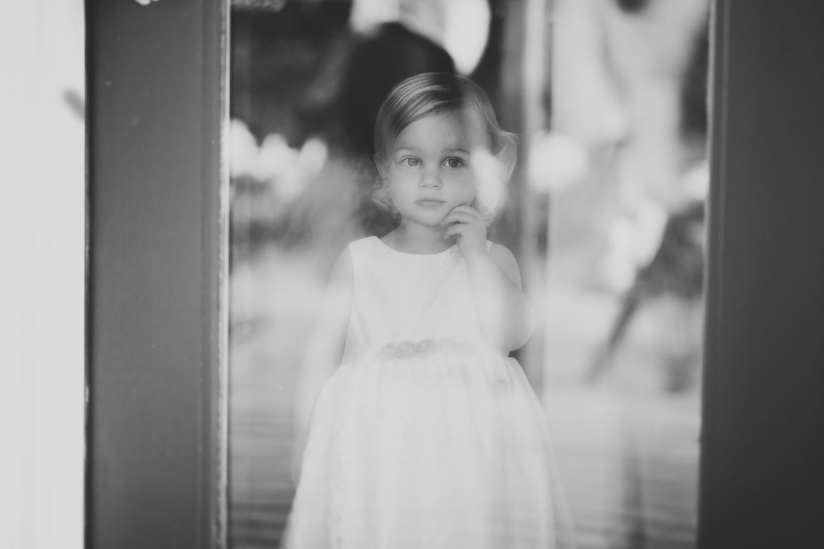 black and white photo of flower girl at wedding  | Susie Moreno Photography
