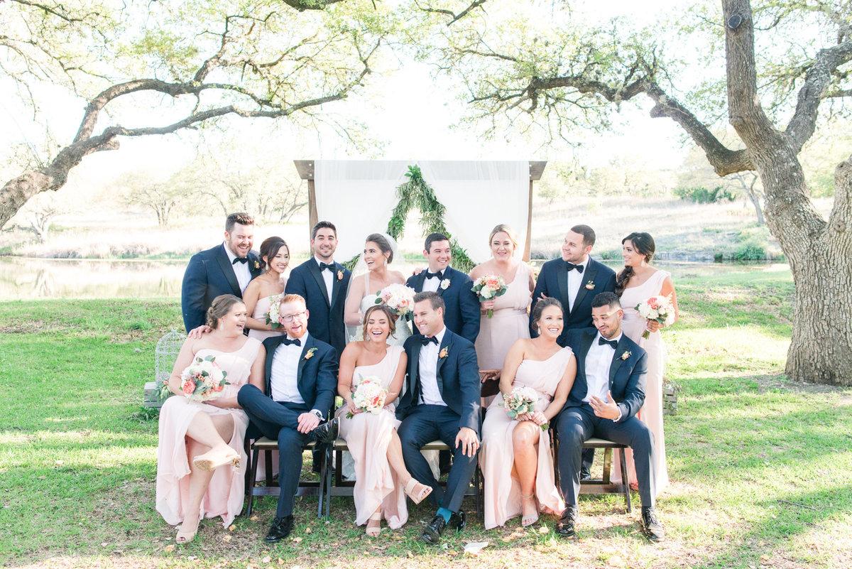 bridal party in blush and navy celebrate friends' wedding at The Addison Grove