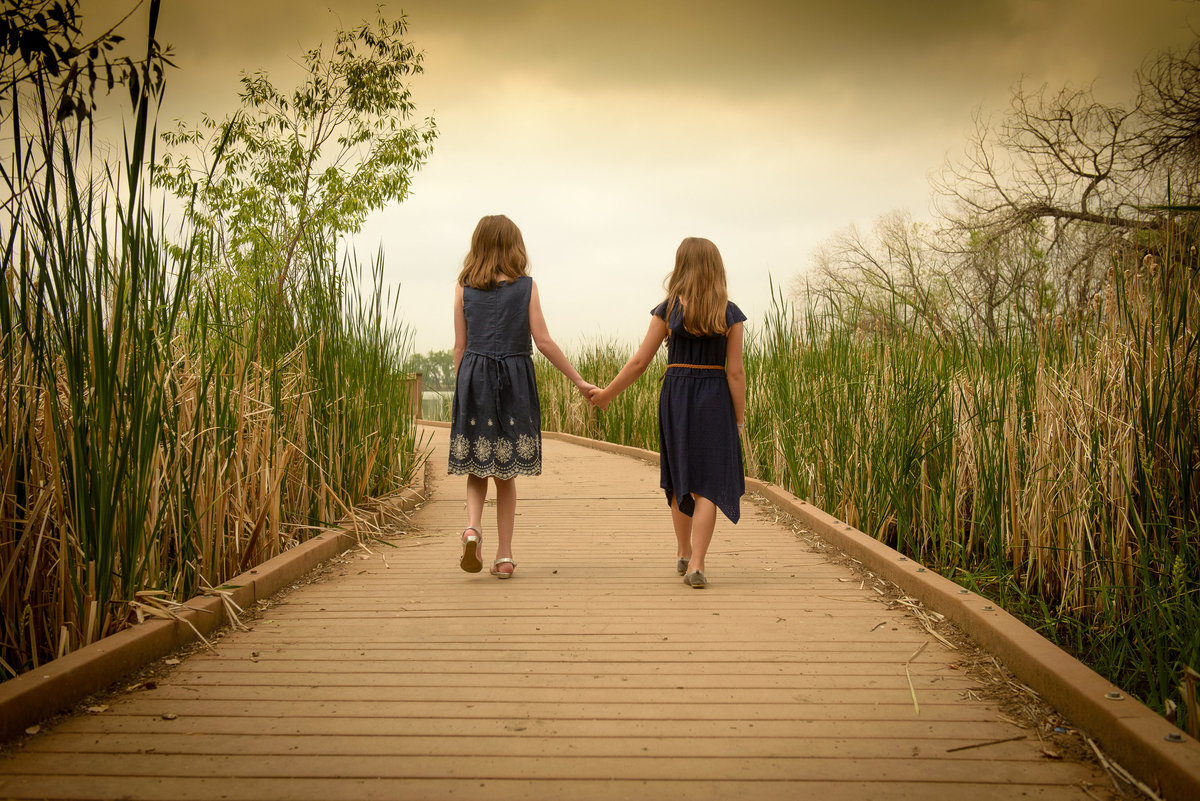 Girls Holding hands at McKay Lake