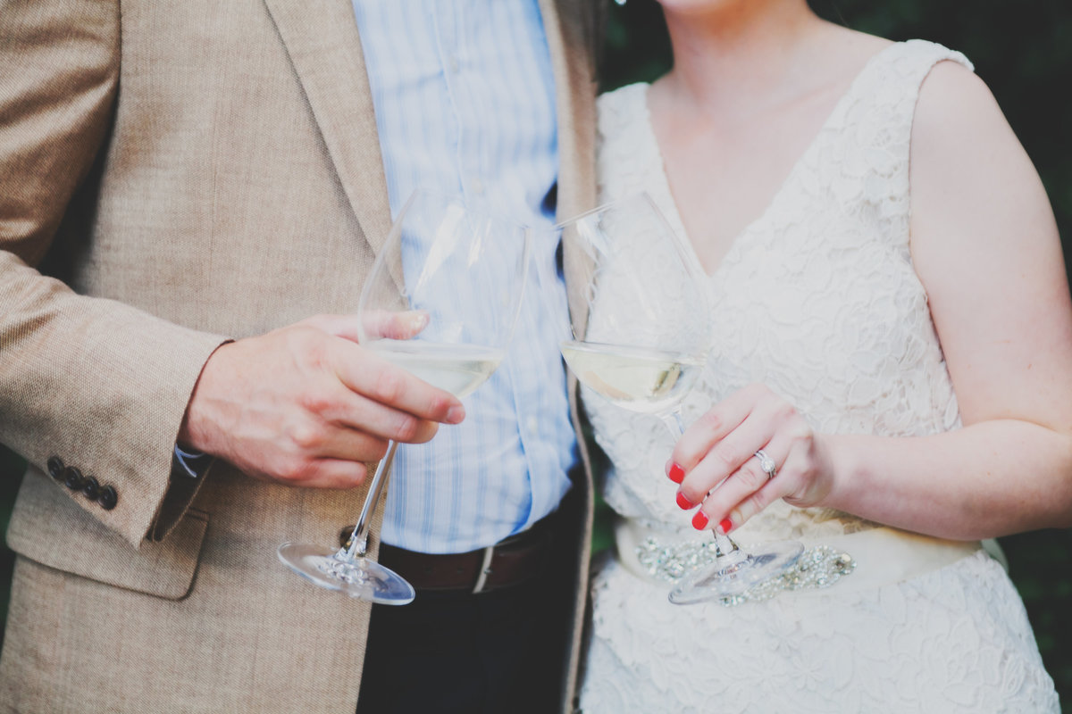 close up photo of bride and groom toasting with wedding flutes  | Susie Moreno Photography