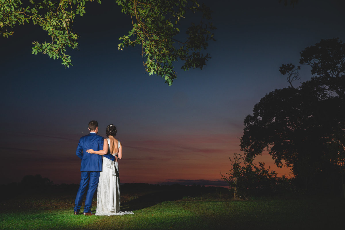 a sunset wedding photograph of the couple looking forward