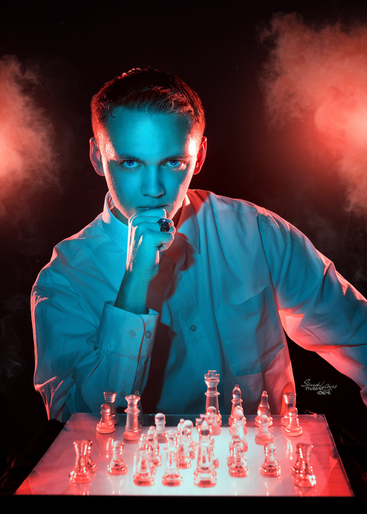 Creative senior portrait with chess set using color gel lights