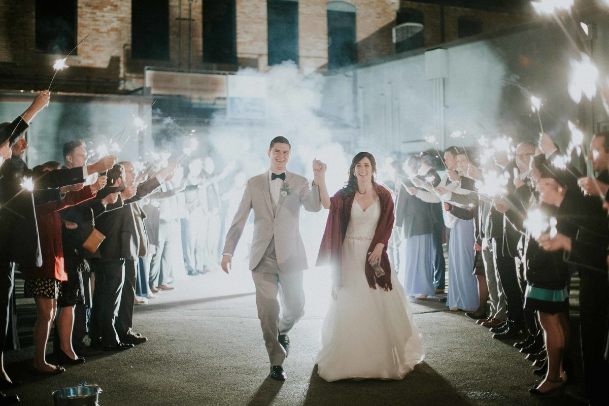 Couple walks out for their sparkler send off at Factory 12 Event in Columbus indiana