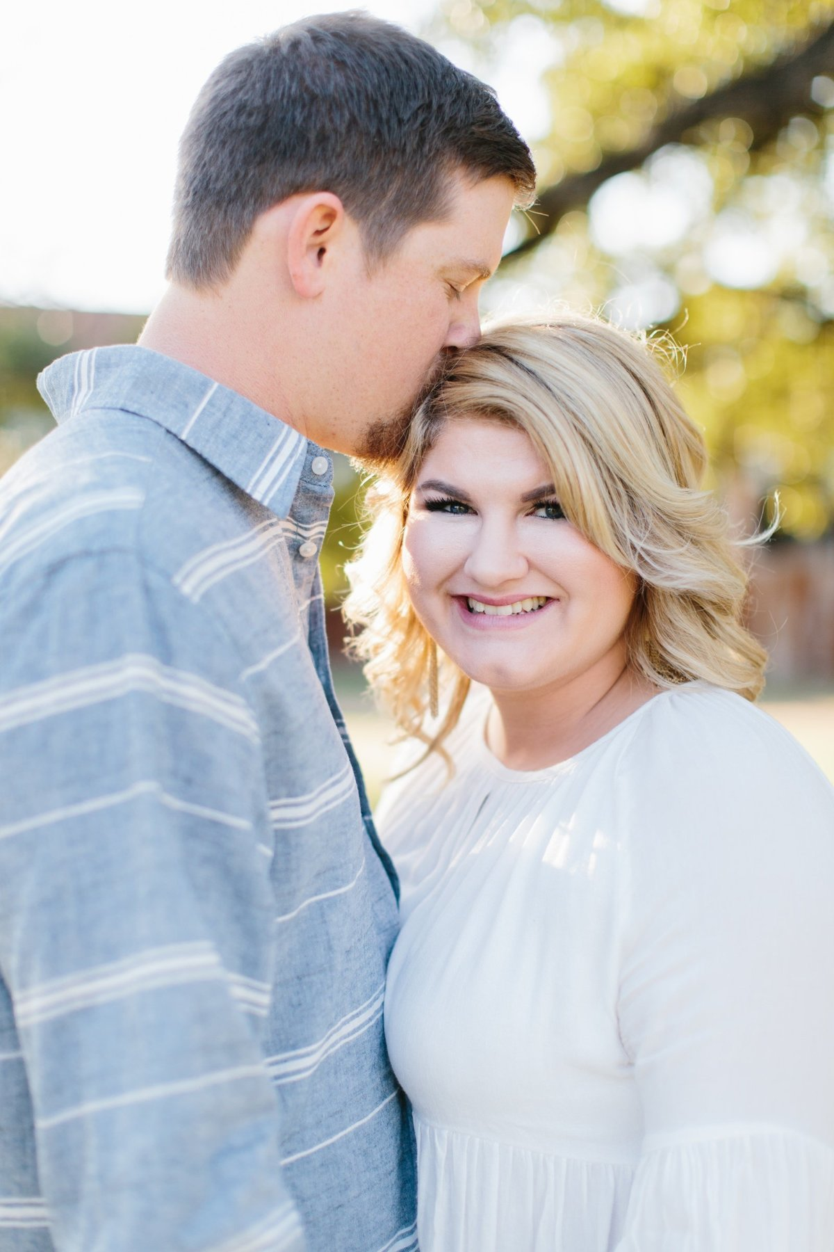 Film Engagement Session in Gruene, Texas. Bride wearing white flowy top, groom is wearing light blue button up.