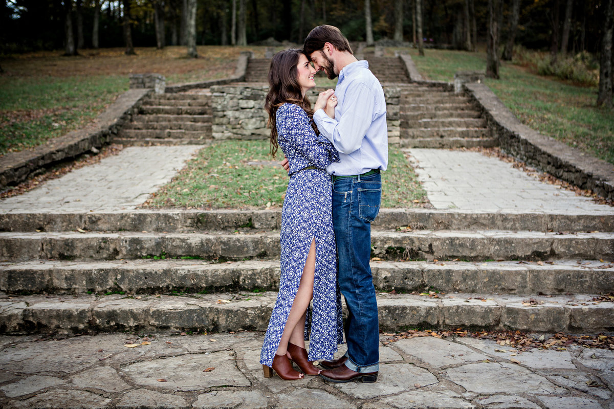 Family pictures done in front of the stone steps while the couple dances in Nashville, TN for their family pictures by Knoxville Wedding Photographer, Amanda May Photos.