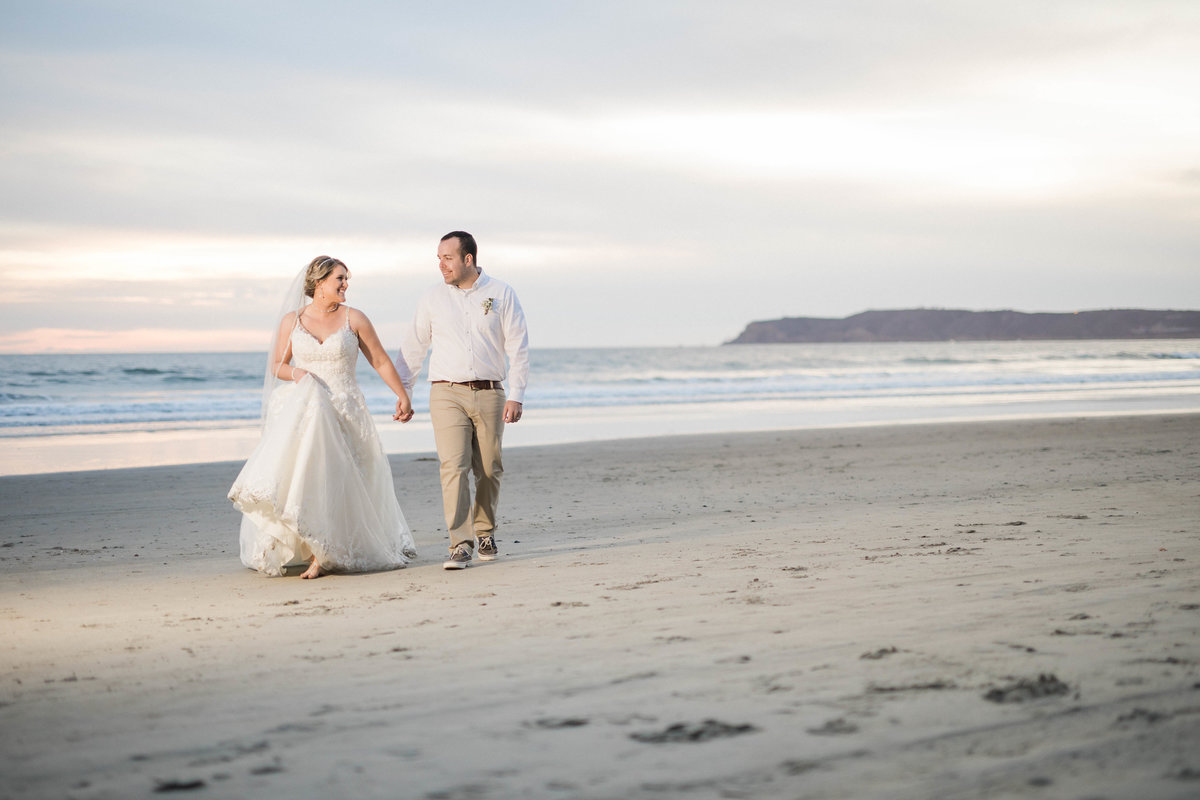Bride and Groom casually walk along the beach in Coronado, CA