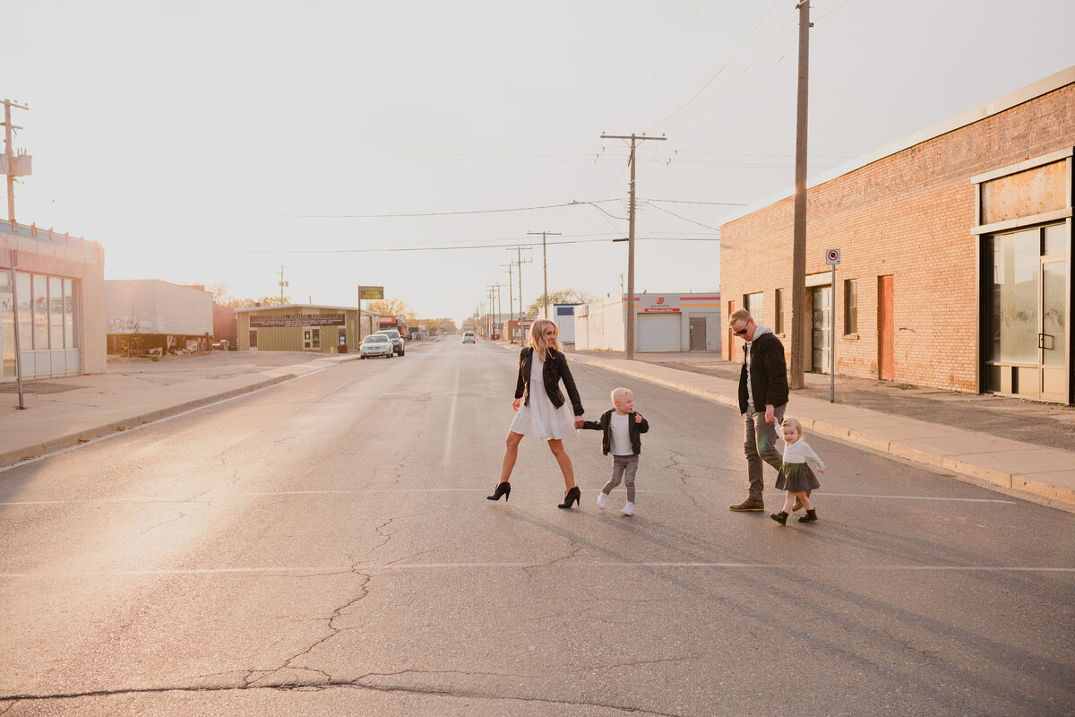 Family walks across the street in Warehouse District Regina