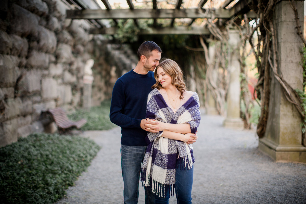 Arms tangled and wrapped looking towards each other under the vines at The Biltmore engagement photo by Knoxville Wedding Photographer, Amanda May Photos.