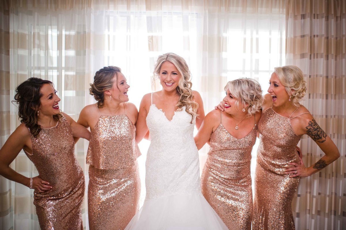 04 Bride and rose gold bridesmaids dresses in villas at waters edge