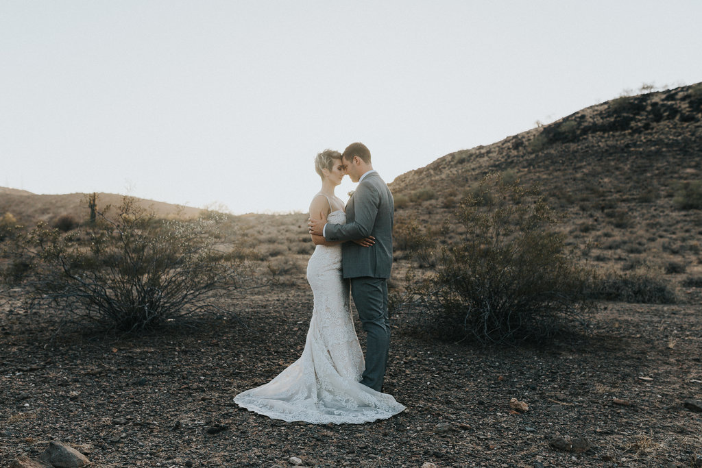 Bride and Groom embrace during their desert elopement in Phoenix, Arizona.