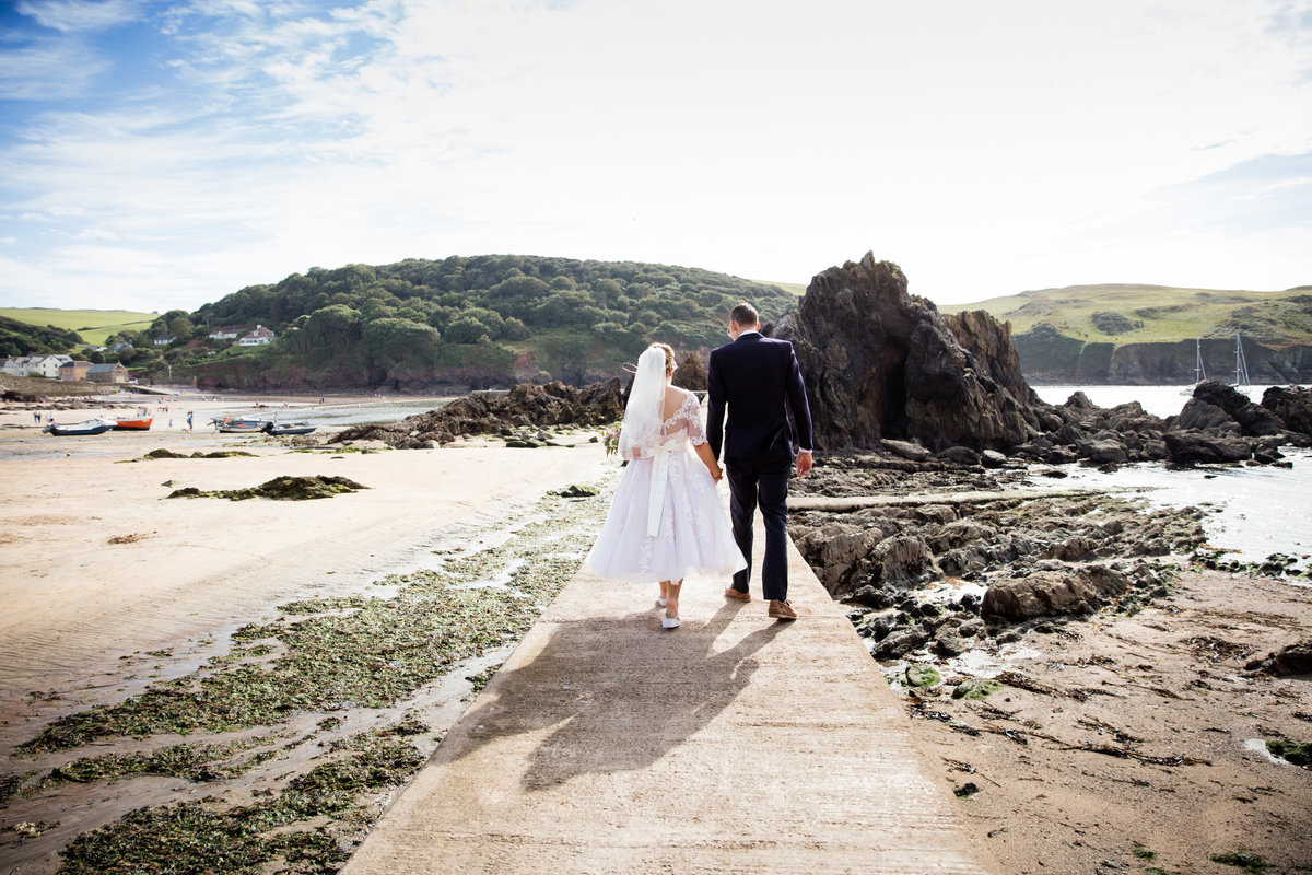 on the sea wall in salcombe devon wedding photographer
