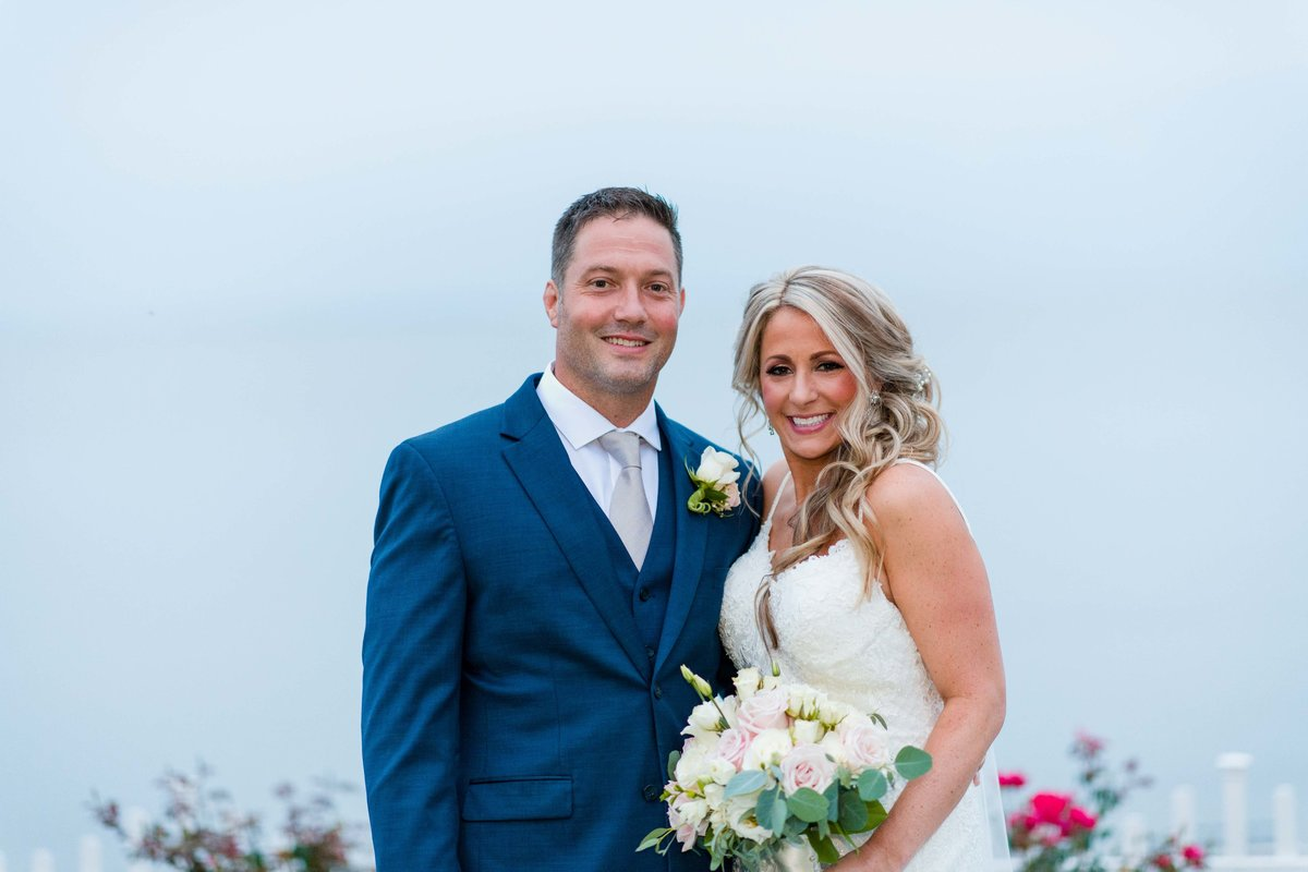 16 Rainy wedding day bride and groom photos at waters edge ct