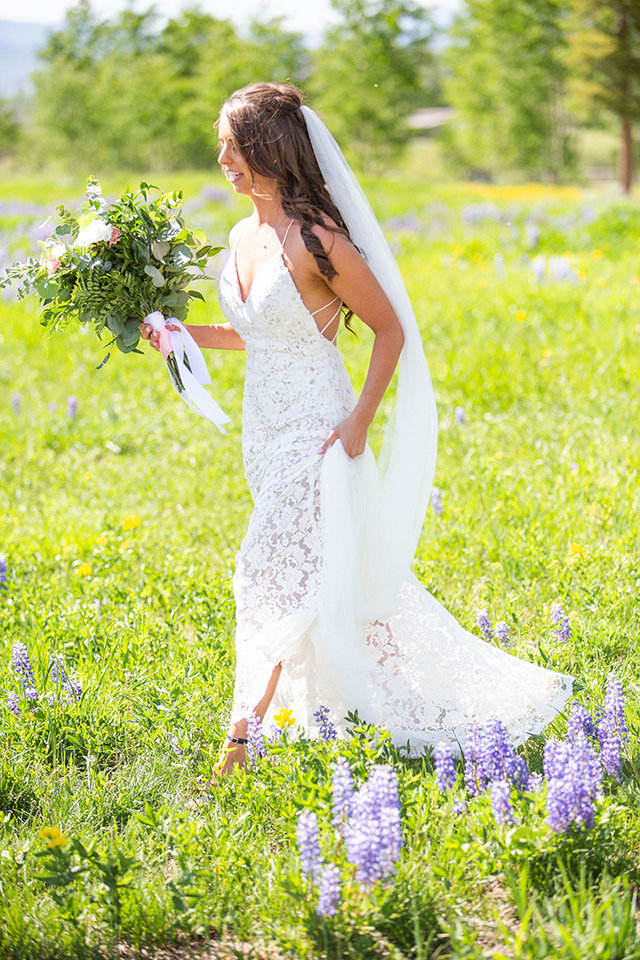 Strawberry-Creek-Ranch-Wedding-Ashley-McKenzie-Photography-Summer-love-on-the-ranch-Bride-Walking-Through-Floral-Fields