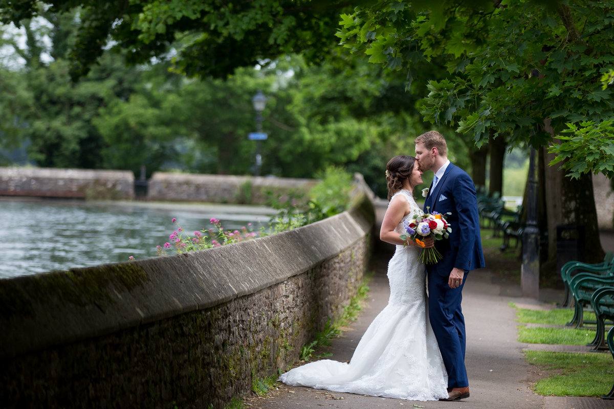 bride and groom at bishops palace wedding somerset