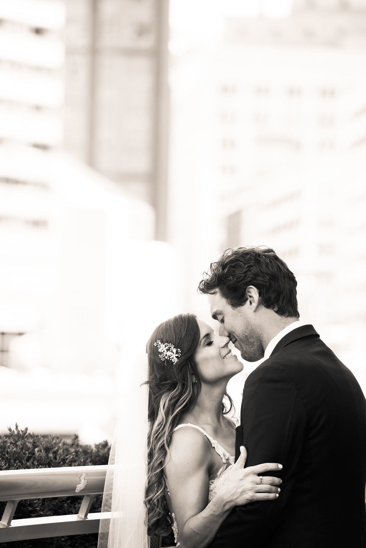 Married couple kiss, Chicago wedding, urban portrait, Riverwalk.