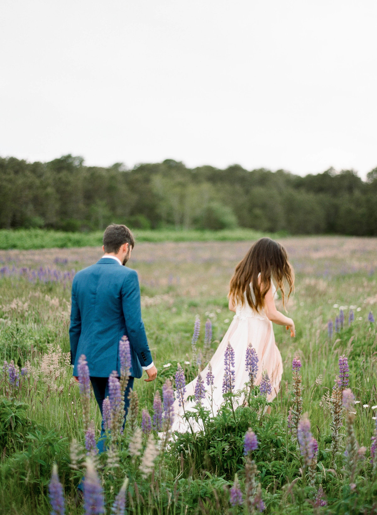 couple in field of flowers wedding nantucket