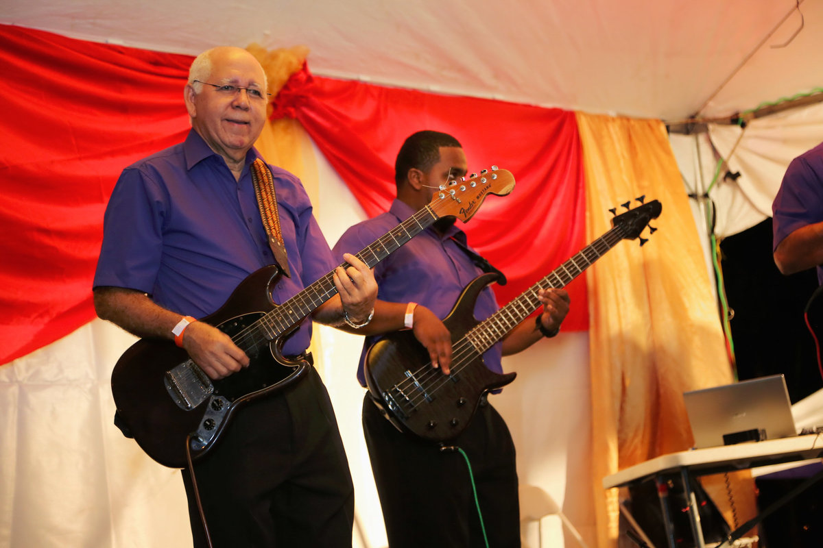 Two guitarists wearing matching purple shirts perform. Photo by Ross Photography, Trinidad, W.I..