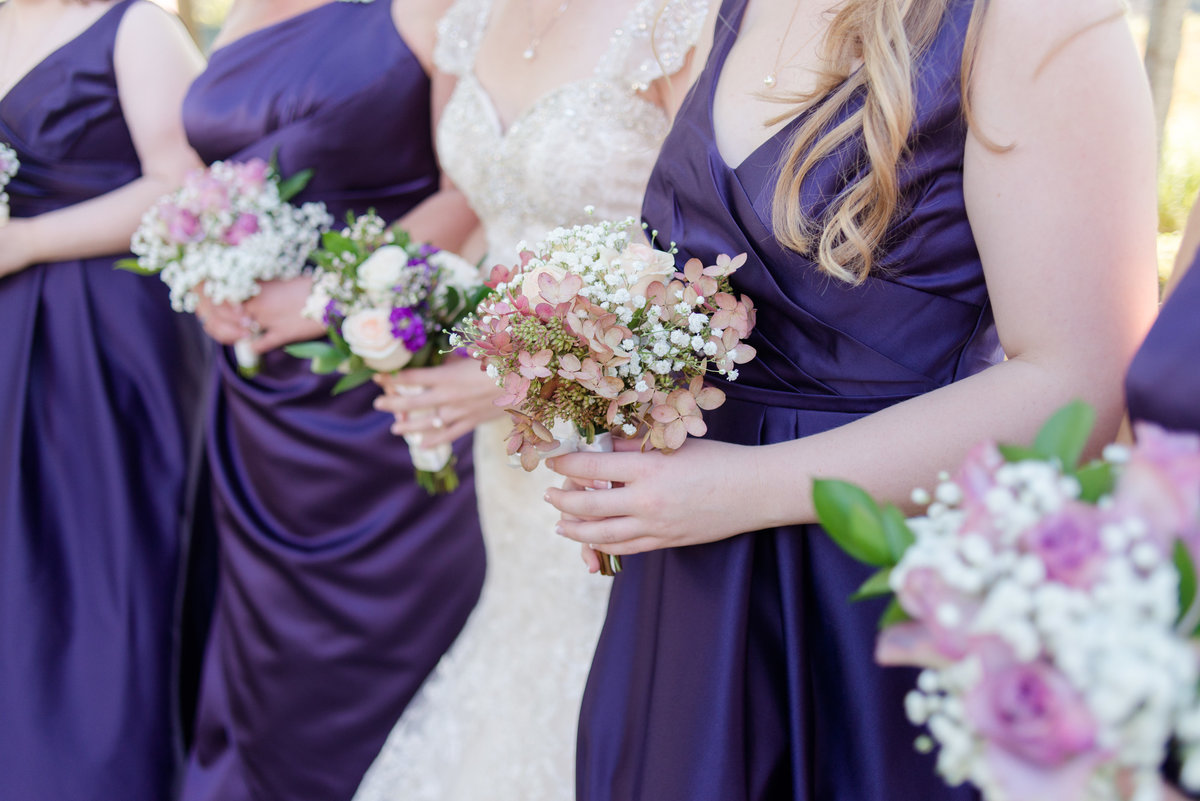 bridesmaids photo all wearing purple