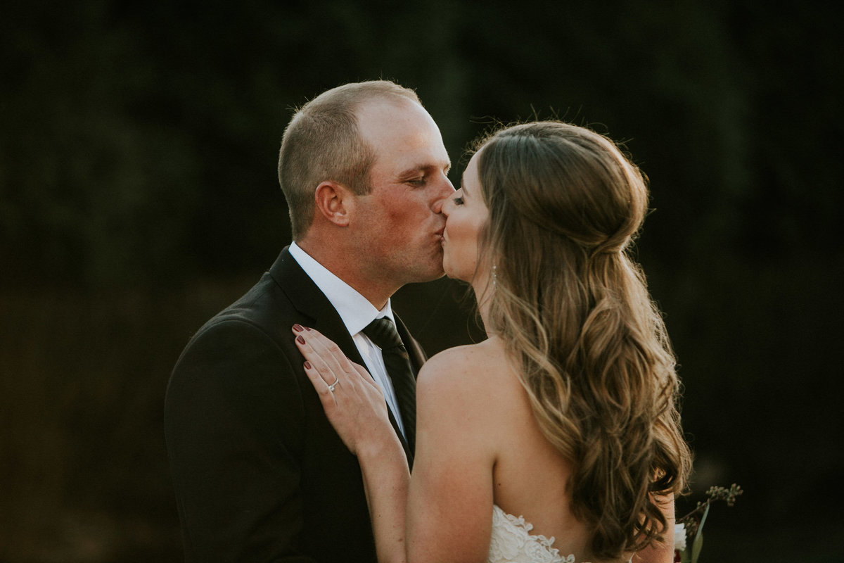 Couple kisses outside at their Ritz Charles wedding