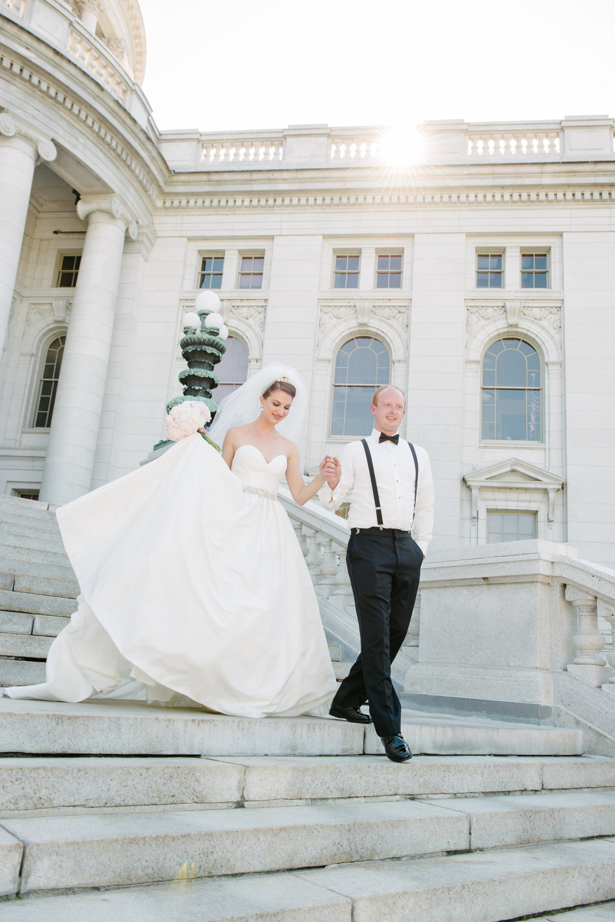 bride and groom walking down capitol steps
