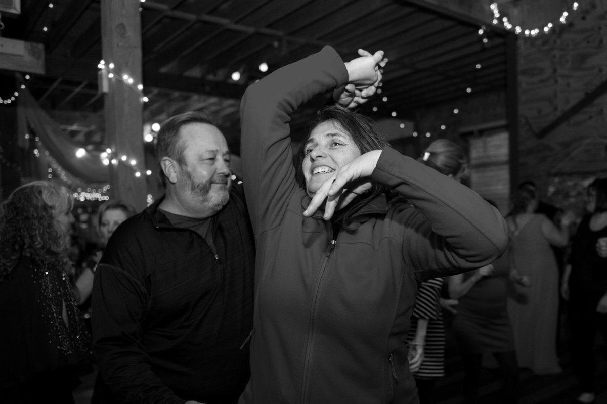 woman spun by spouse at party dance black and white photo