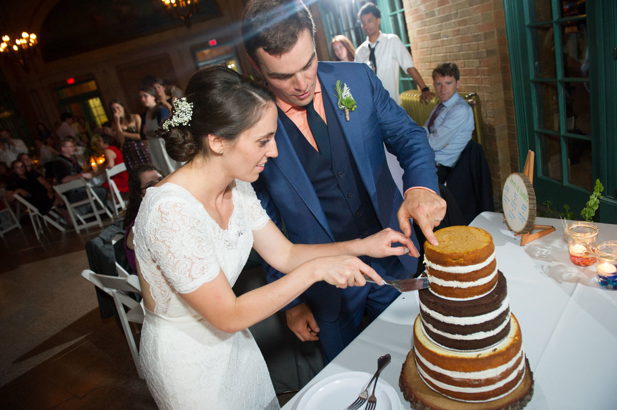 Bride and groom cut cake at reception, Columbus Park, Chicago.
