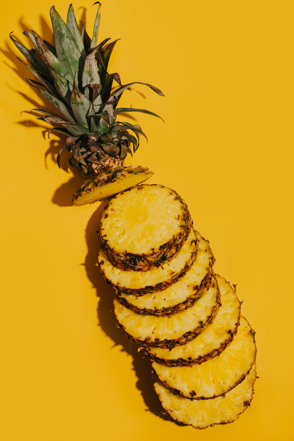 sliced pineapple on yellow
