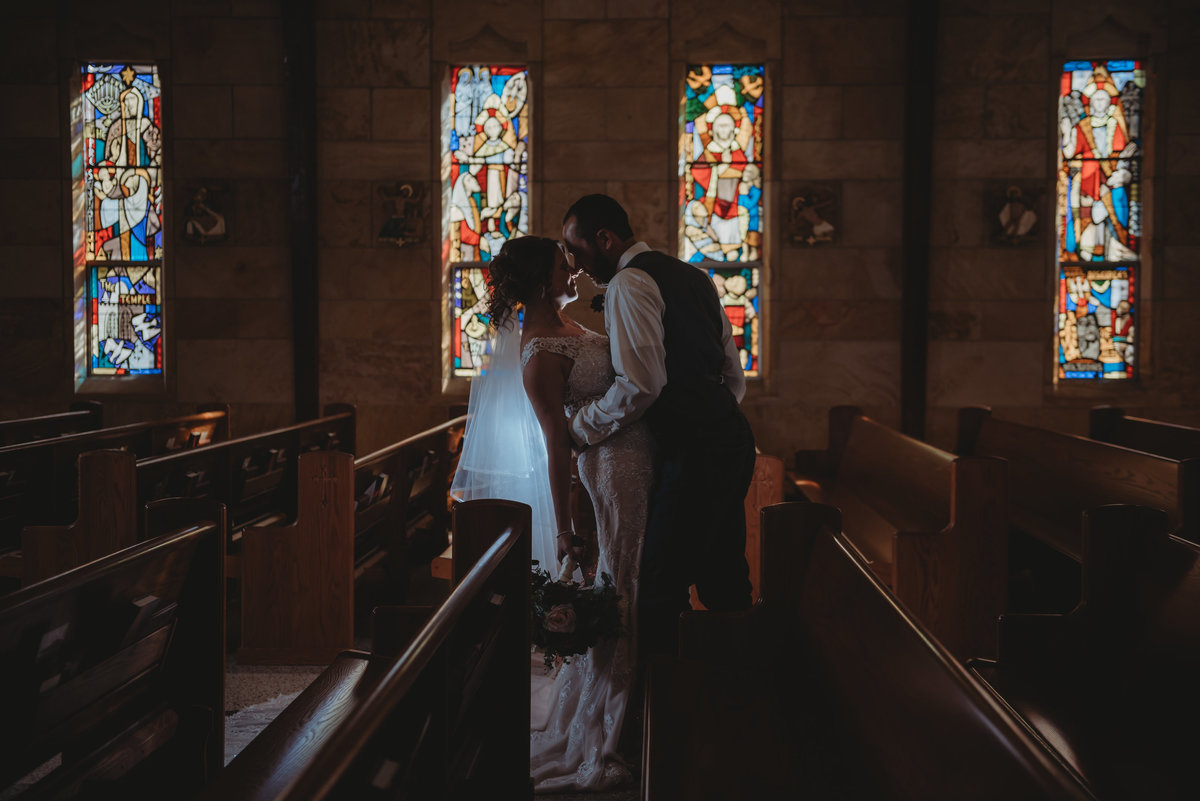 wedding photographer stained glass evansville indiana