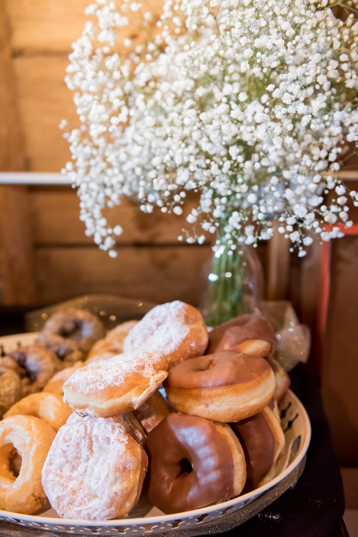 Donuts at a breakfast wedding reception brunch. Modern trends and cool vibes. Sandy's donuts Fargo. www.kriskandel.com