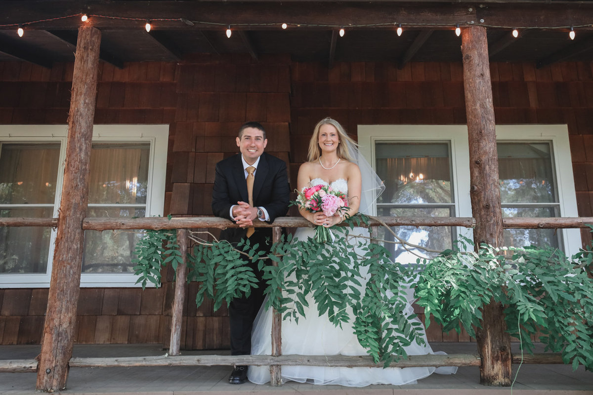 Bride and groom, rustic cabin, greenery, bride and groom love wedding photography
