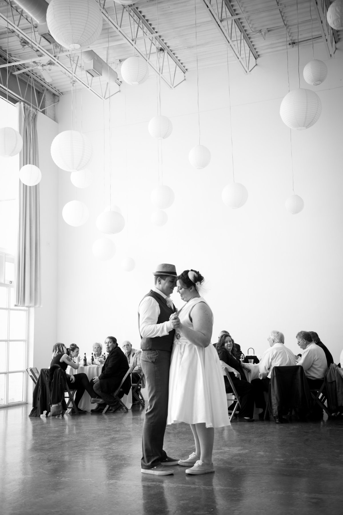 Bride and groom share first dance at reception, wedding, Chicago.