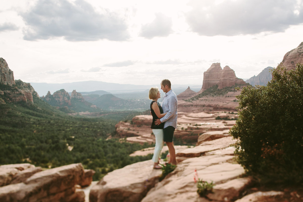 couple on top of Merry-Go-Round Rock in Sedona, AZ