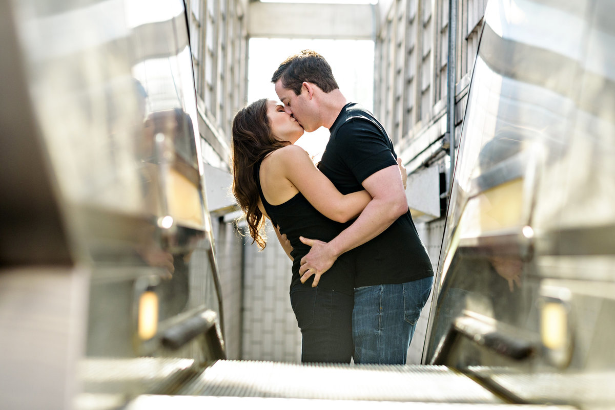 A kissing couple ride the escalator all the way to the top.