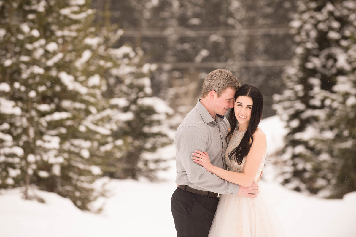 Beautiful Big White ski hill resort engagement photos in the snow while snowing