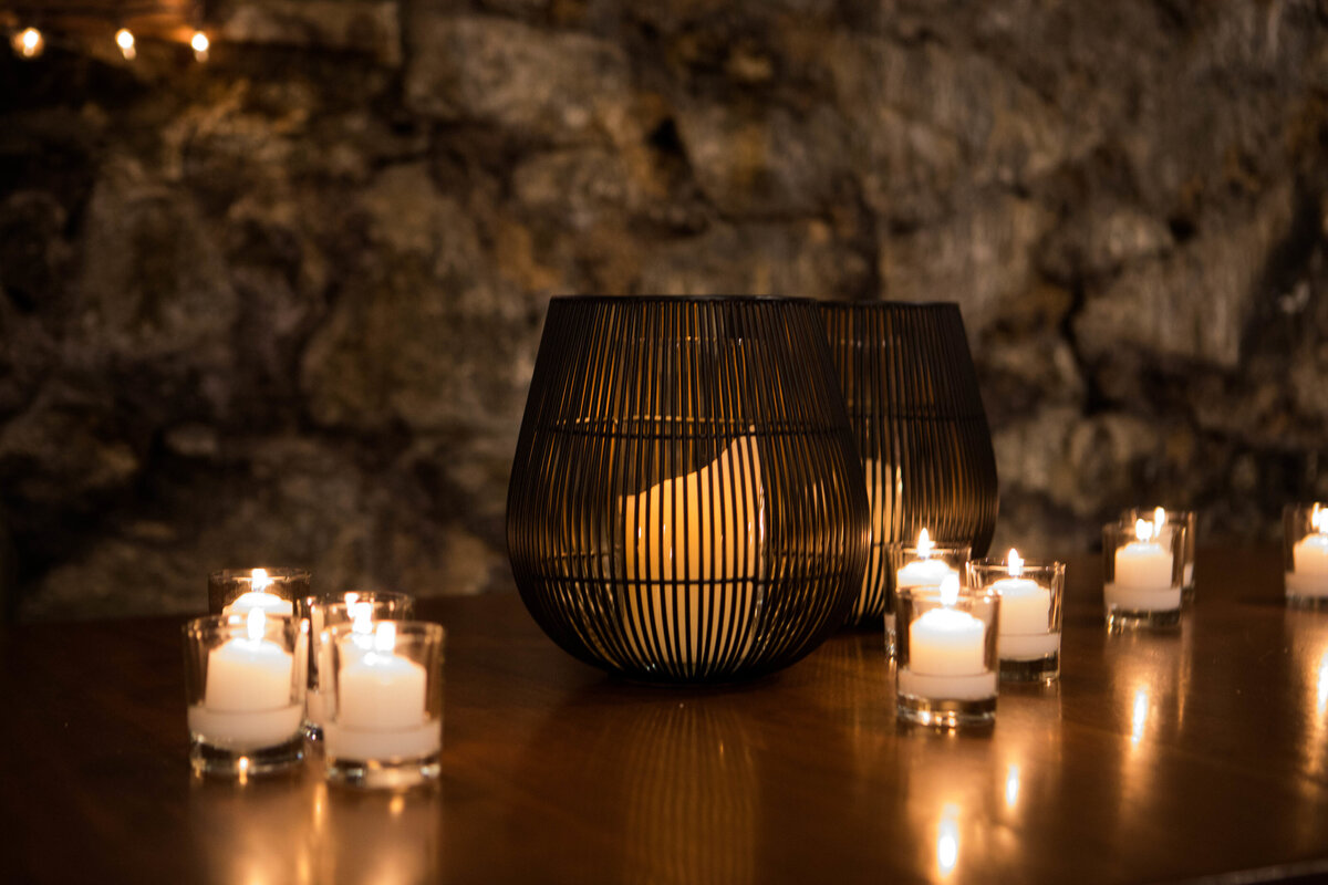 rock wall with candles