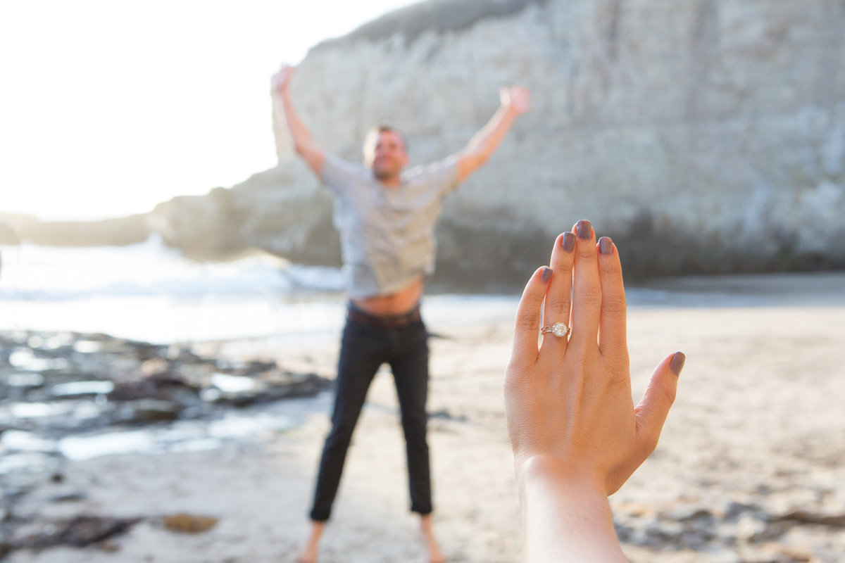 Engagement session on beach, boho theme, bride engagement ring and groom jumping, deneffe studios