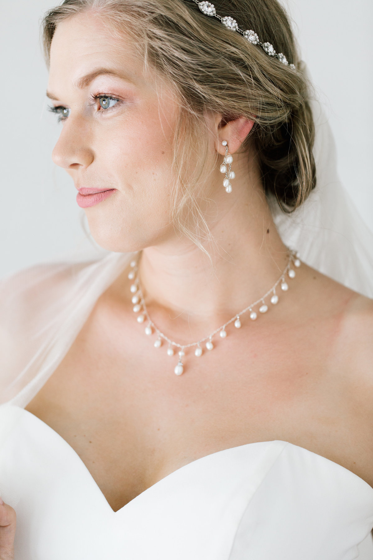 bride wearing necklace and earrings