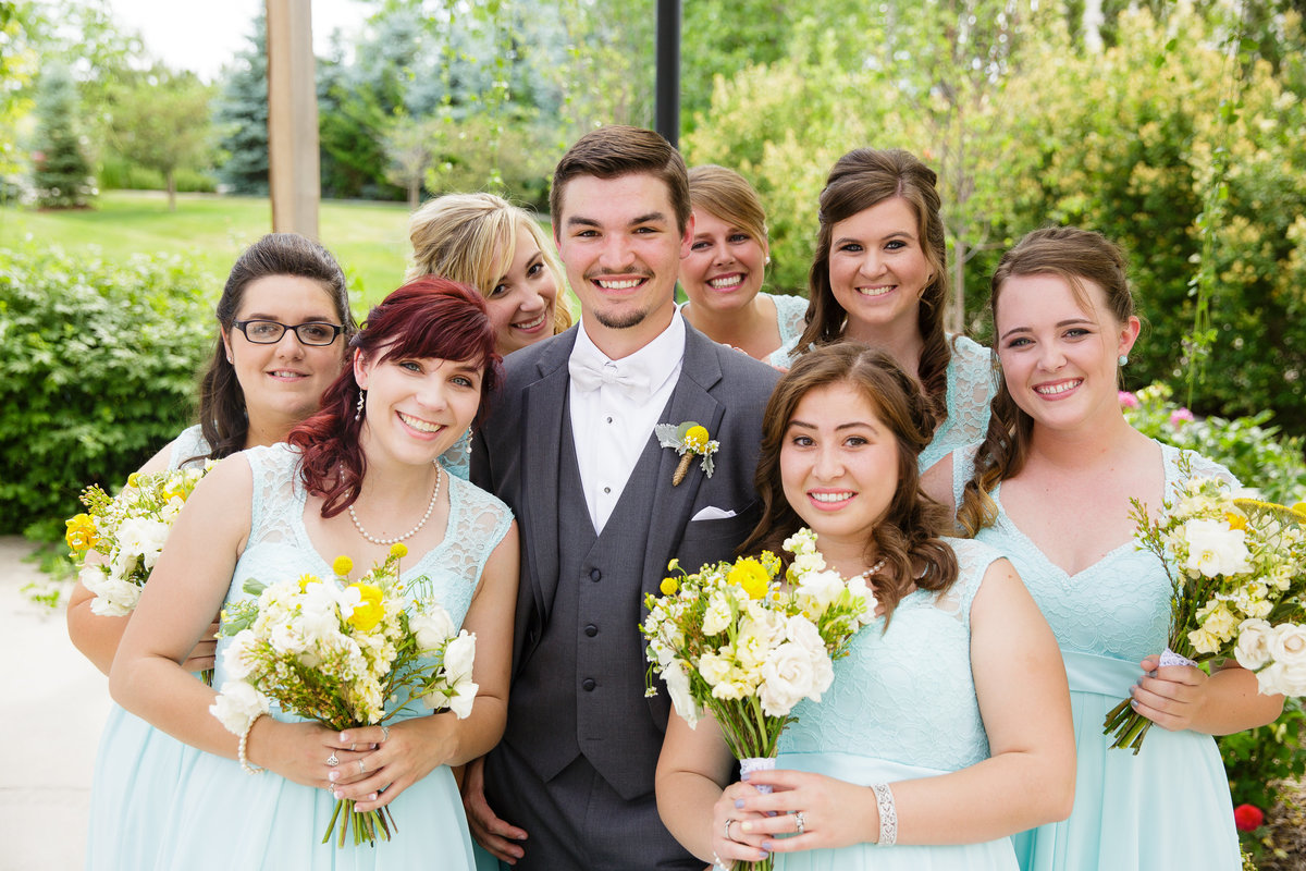 groom-bridesmaids-pose-garden-wedding-in-Colorado