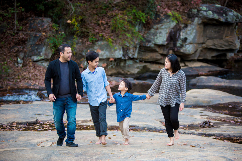 Family portrait walking bare feet candid moment water fall