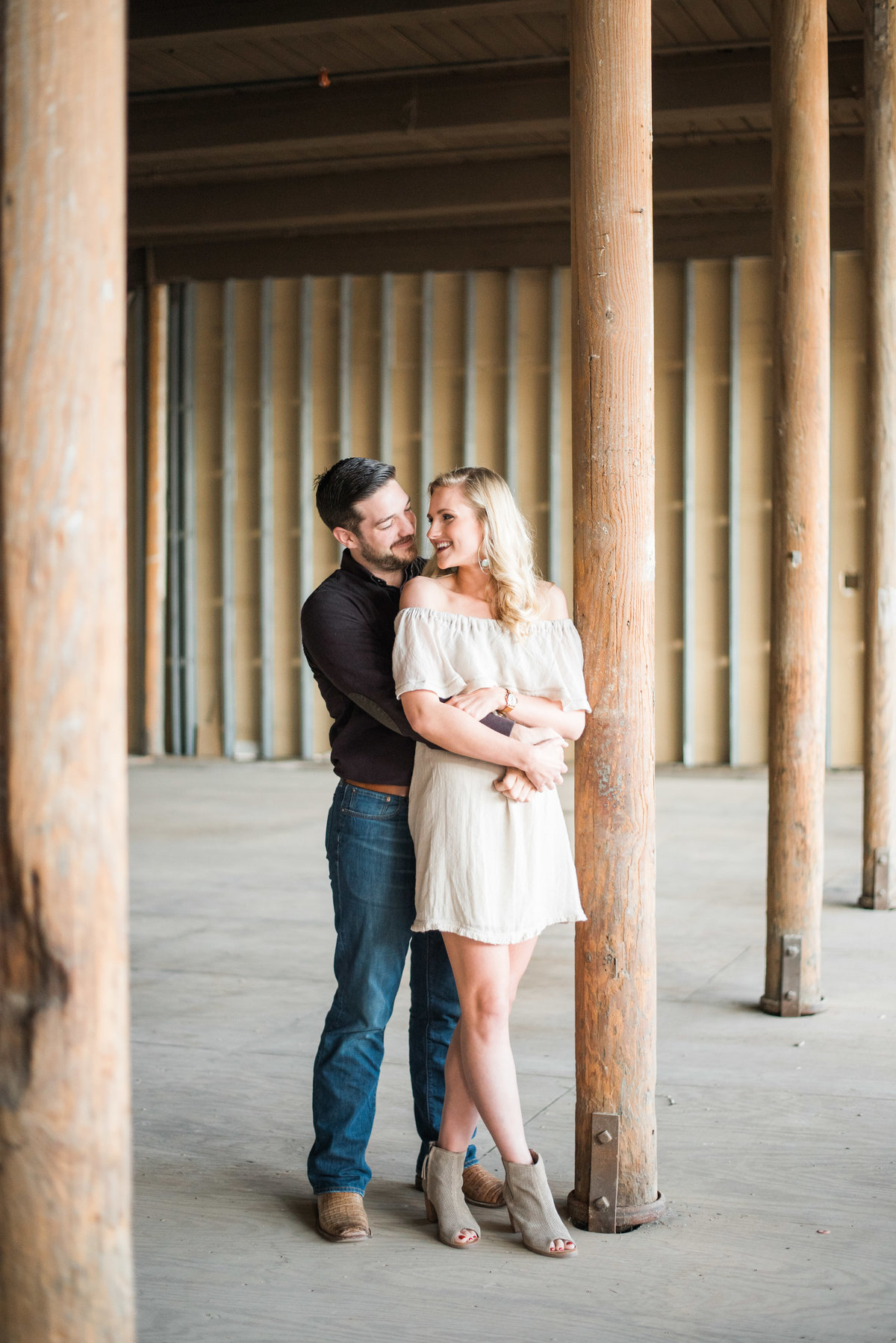 mckinney cotton mill engagement photos couple in warehouse