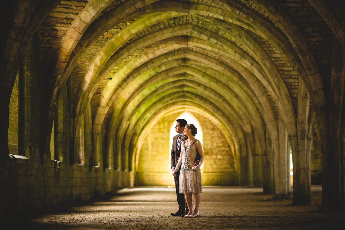 cool architechture in this wedding photo of a couple at fountains abbey