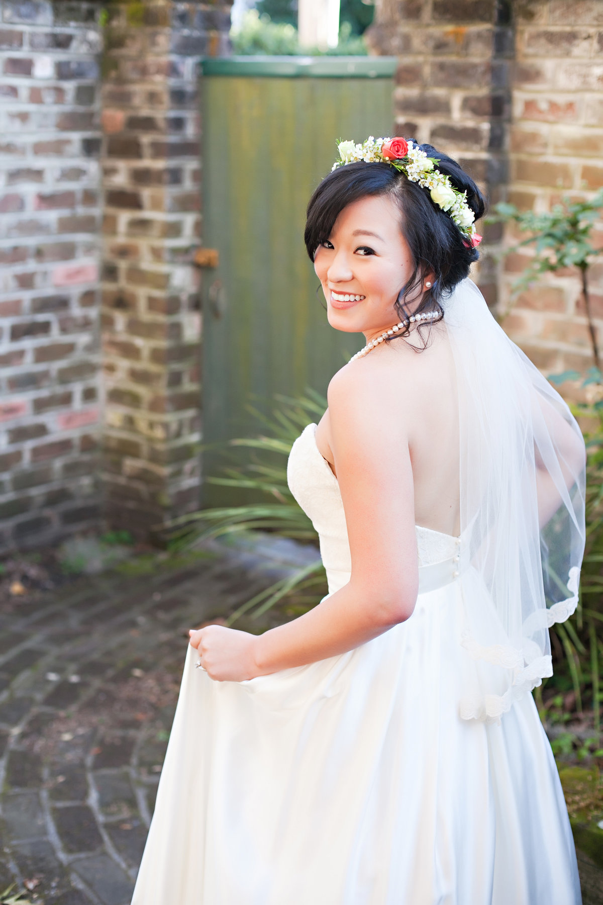 Savannah Bride Portrait Flower Crown Veil Wedding Dress Garden Courtyard