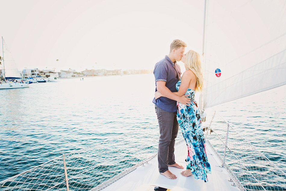 engaged couple on a sailboat