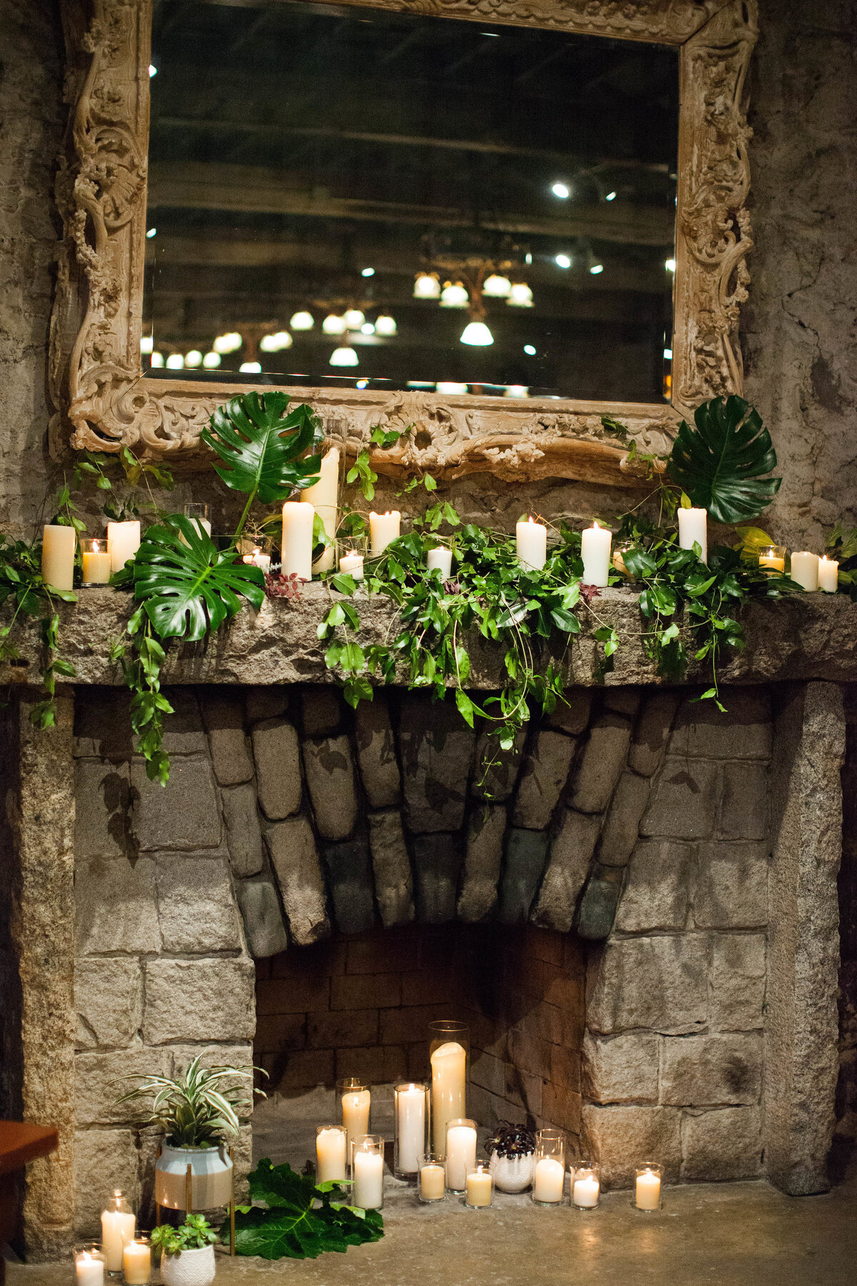 fire place with greenery and candles