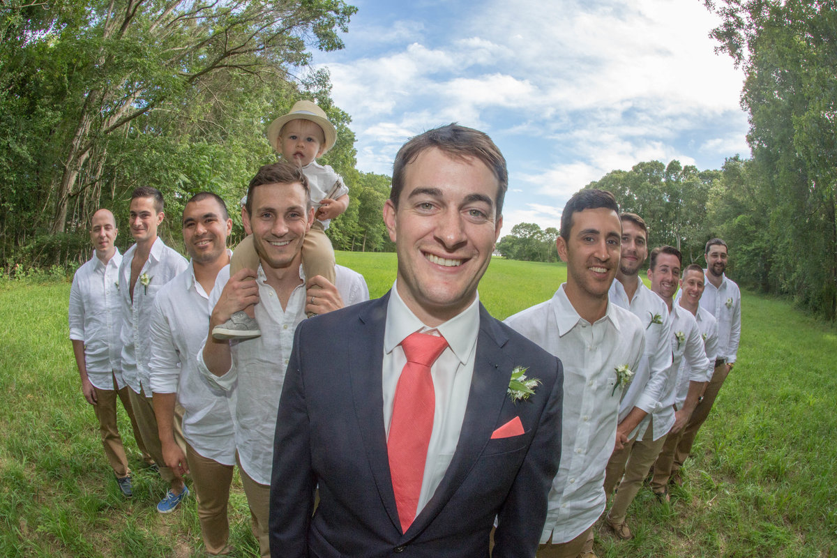 closeup of groom and groomsmen in field