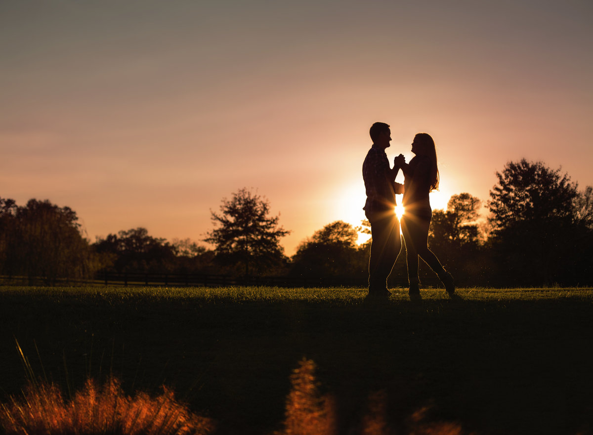 Couple pose at sunset during an engagement session in Charlotte NC