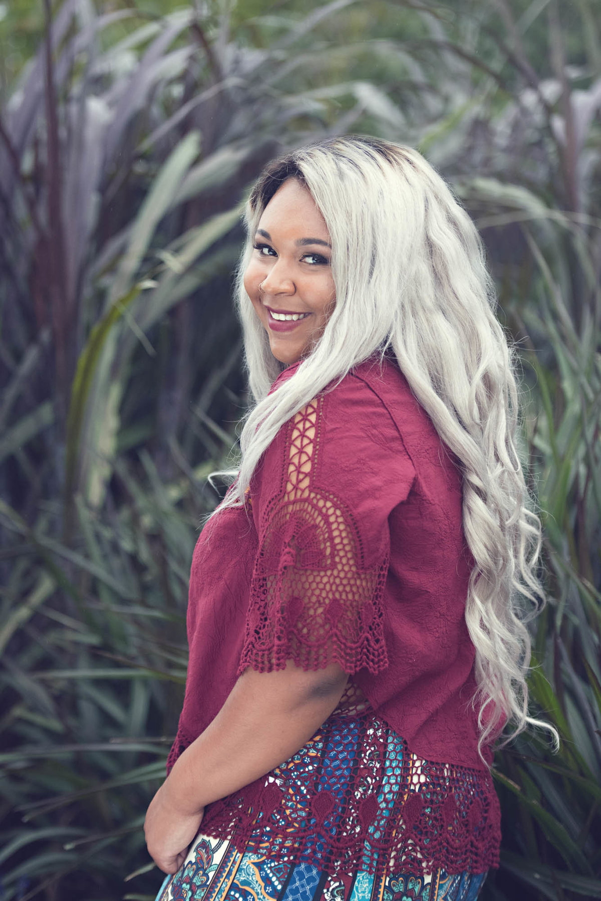 Senior girl of color gorgeous white hair smling photographer