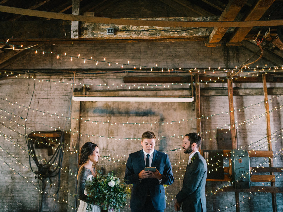 industrial portland maine wedding ceremony string light backdrop
