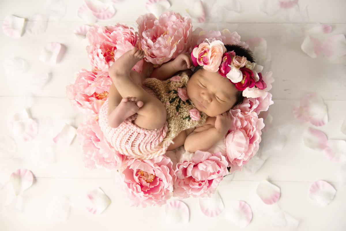 Flowers and Newborn Girl