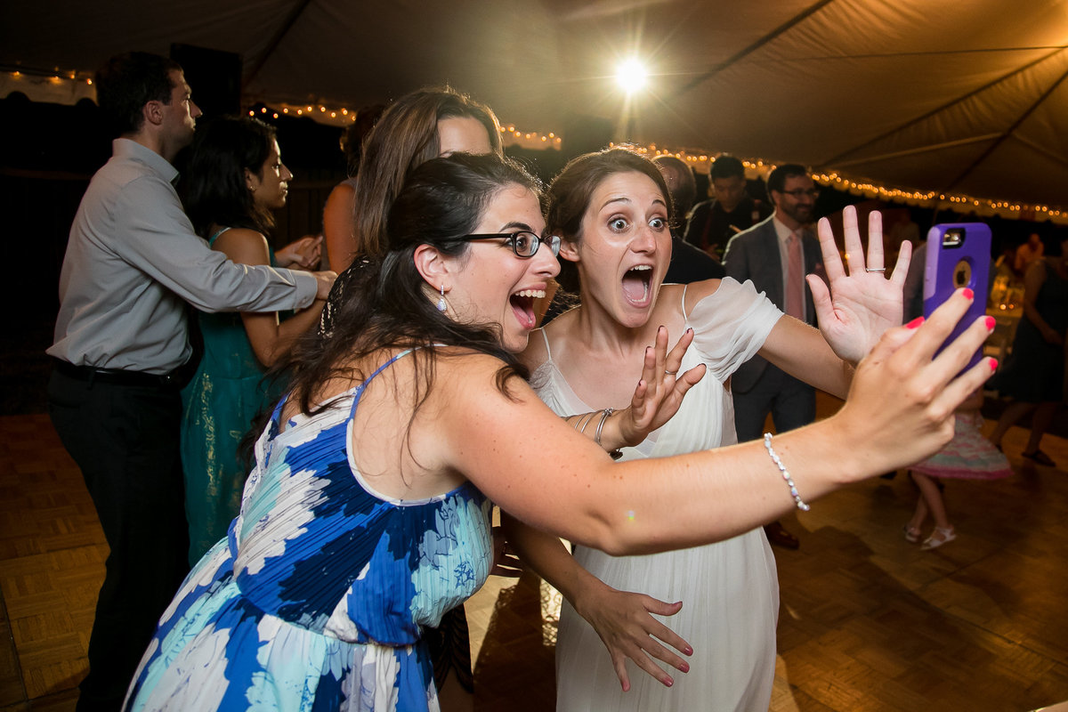 Brooklyn Wedding Photographer | Rob Allen Photography | Destination Wedding Photographer at Mt. Sinai New York surprised by friend while facetiming